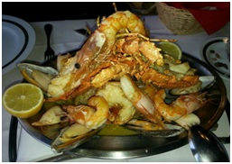 """<ul> <li>Couvert w/bread, butter and olives</li> <li>Special Smoked ham, Country Portuguese cheese</li> <li>Portuguese codfish cake, Shrimp patties</li> <li>Squids' """" Al Agullo""""</li> <li>Mixed grilled w/lobster, prawns, squids and mussels w/ roast potatoes</li> <li>Tropical mix fruit</li> <li>Red or white wine, water</li> <li>Coffe</li> </ul>"""